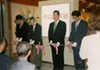 A tape cutting ceremony with the mayor of Uozu Town